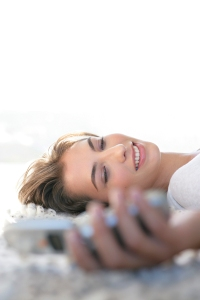 Woman holding cell phone, sexting