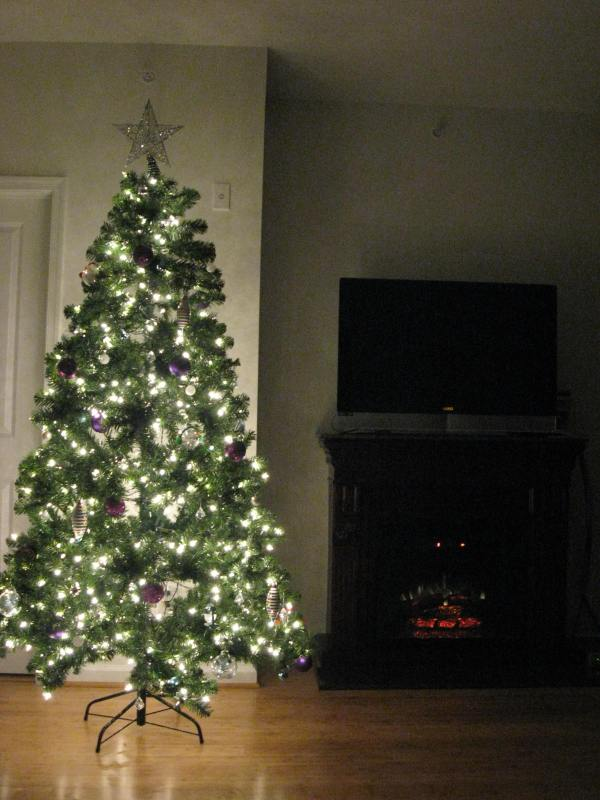 Christmas tree next to a fireplace