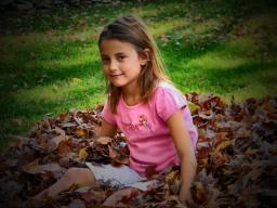 child playing in leaves, fall folliage