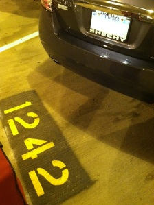 car in parking spot at airport