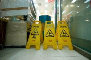 caution signs, yellow cones, slippery when wet