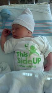 This Side Up baby onesie